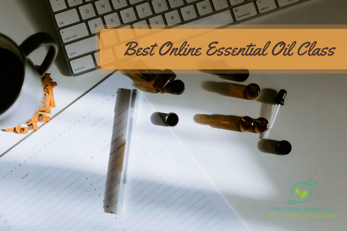 Keyboard, paper, and essential oils in the background of a header saying 'Best Online Essential Oil Class'